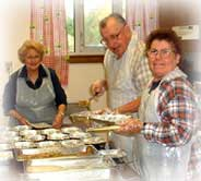 A photograph of volunteers preparing lunch at one of the centers.